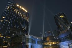 The new Melco Crown Entertainment gaming resort City of Dreams and the first Hard Rock Hotel in Macau are illuminated during its opening ceremony June 1, 2009 file photo. REUTERS/Tyrone Siu