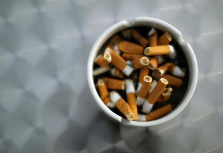 An ash tray with cigarette butts is pictured in Hinzenbach, in the Austrian province of Upper Austria, February 5, 2012. REUTERS/Lisi Niesner