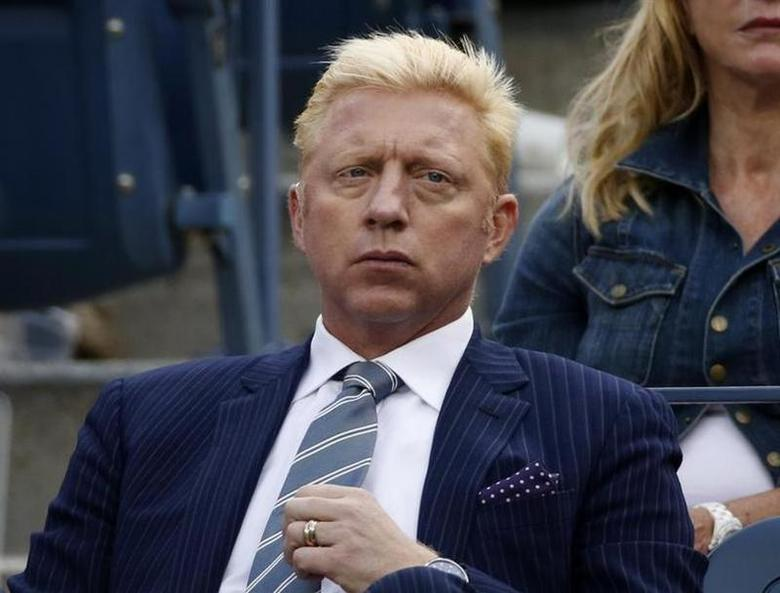 Tennis great Boris Becker of Germany watches the match between Richard Gasquet of France and Rafael Nadal of Spain during the men's semi-finals at the U.S. REUTERS/Mike Segar