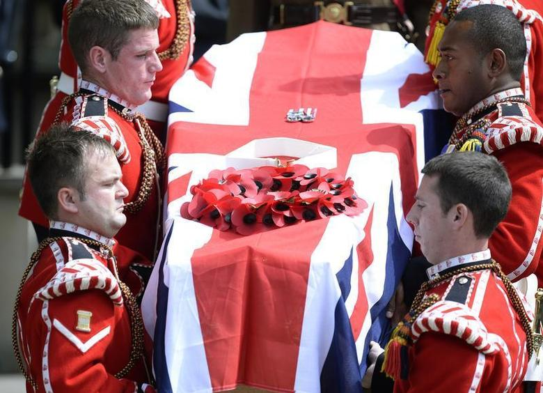 The coffin of Fusilier Lee Rigby is carried by members of his regiment after his funeral service at the parish church in Bury, northern England July 12, 2013. REUTERS/Nigel Roddis