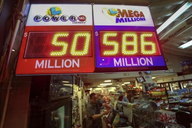 A worker at Nick's Liquor Store sells lottery tickets as a sign shows the Mega Millions jackpot estimated at $586 million in Venice, California December 16, 2013. REUTERS/Jonathan Alcorn