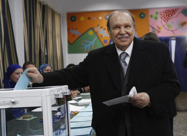 Algeria's President Abdelaziz Bouteflika smiles during a ballot for the regional and municipal elections at a polling station in Algiers November 29, 2012. REUTERS/Louafi Larbi