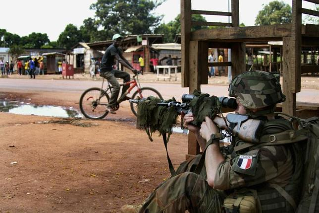 A French military sniper readies his rifle in Bangui December 8, 2013. REUTERS/Herve Serefio