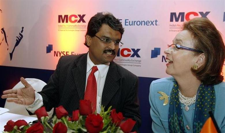 India's Multi Commodity Exchange (MCX) Managing Director Jignesh Shah (L) speaks with former New York Stock Exchange (NYSE) Euronext President Catherine Kinney during a news conference in Mumbai February 15, 2008. REUTERS/Punit Paranjpe/Files