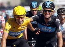 Sky Procycling rider and leader's yellow jersey Bradley Wiggins of Britain (L) is congratulated by team mate Michael Rogers of Australia after the final 20th stage of the 99th Tour de France cycling race between Rambouillet and Paris, July 22, 2012. REUTERS/Jean-Paul Pelissier