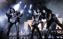 (L-R) Gene Simmons, Tommy Thayer and Paul Stanley of rock band Kiss perform during a concert on their Latin America tour, at the Jockey Club in Asuncion November 12, 2012. REUTERS/Jorge Adorno