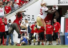 Dec 15, 2013; Tampa, FL, USA; San Francisco 49ers tight end Vernon Davis (85) catches the ball for a touchdown during the first half against the Tampa Bay Buccaneers at Raymond James Stadium. Kim Klement-USA TODAY Sports