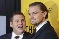 "Cast members Leonardo DiCaprio (R) and Jonah Hill arrive for the premiere of the film ""The Wolf of Wall Street"" in New York in this file photo from December 17, 2013. REUTERS/Lucas Jackson"