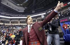 Will Ferrell as Ron Burgundy salutes the crowd at the Roar of the Rings Canadian Olympic Curling Trials in Winnipeg, Manitoba December 1, 2013. REUTERS/Trevor Hagan