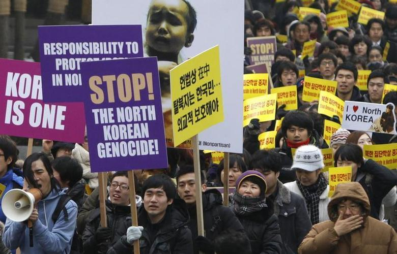 South Korean Christians and former North Korean defectors living in the South march during a rally to protest against what they say is North Korea's violation of human rights, in Seoul January 27, 2012. REUTERS/Kim Hong-Ji