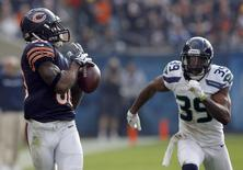 Chicago Bears wide receiver Earl Bennett (80) drops a pass as Seattle Seahawks cornerback Brandon Browner (39) defends during the first half of their NFL football game at Soldier Field in Chicago December 2, 2012. REUTERS/Jeff Haynes