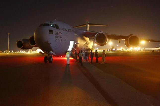 A U.S. Air Force plane carrying two Sudanese detainees released from the Guantanomo facility from Guantanamo in Cuba, arrives at Khartoum Airport early December 19, 2013. REUTERS/Mohamed Nureldin Abdallah