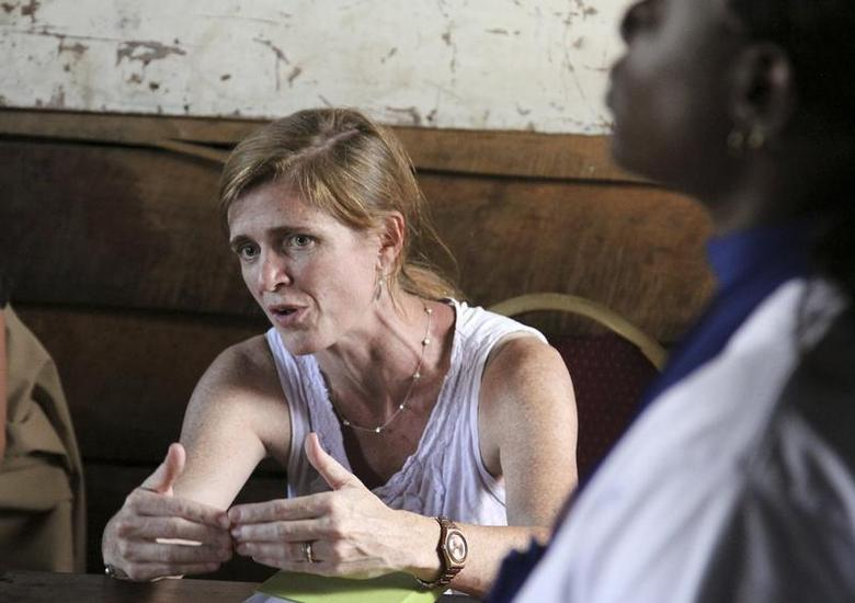 U.S. Ambassador to the United Nations Samantha Power speaks to a Congolese woman at the Mugunga 3 camp for internally displaced people near Goma, the capital of North Kivu province in eastern Democratic Republic of Congo, October 6, 2013. REUTERS/Michelle Nichols