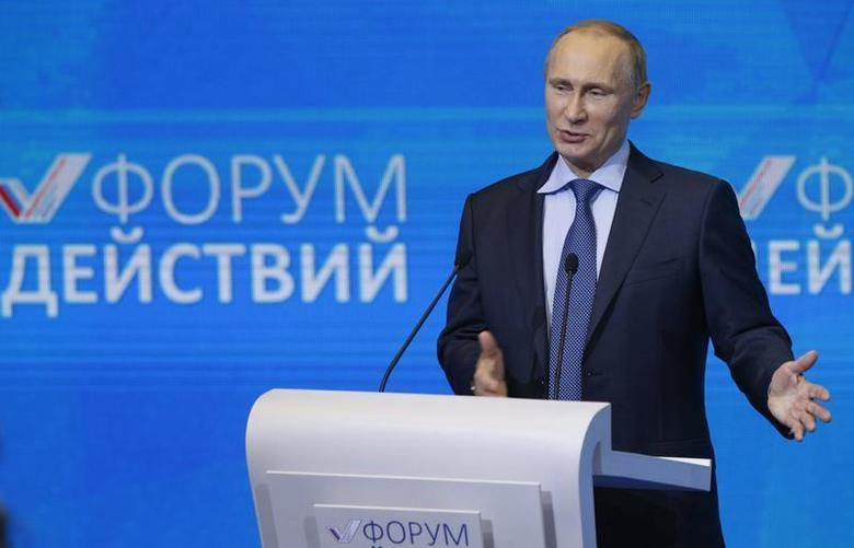 Russian President Vladimir Putin addresses the audience during a meeting with members of the All-Russian People's Front group in Moscow, December 5, 2013. REUTERS/Alexander Zemlianichenko/Pool