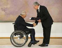 Wolfgang Schaeuble (L) receives his certificate of appointment as Finance Minister from President Joachim Gauck during a ceremony in the Bellevue Palace in Berlin December 17, 2013. REUTERS/Fabrizio Bensch