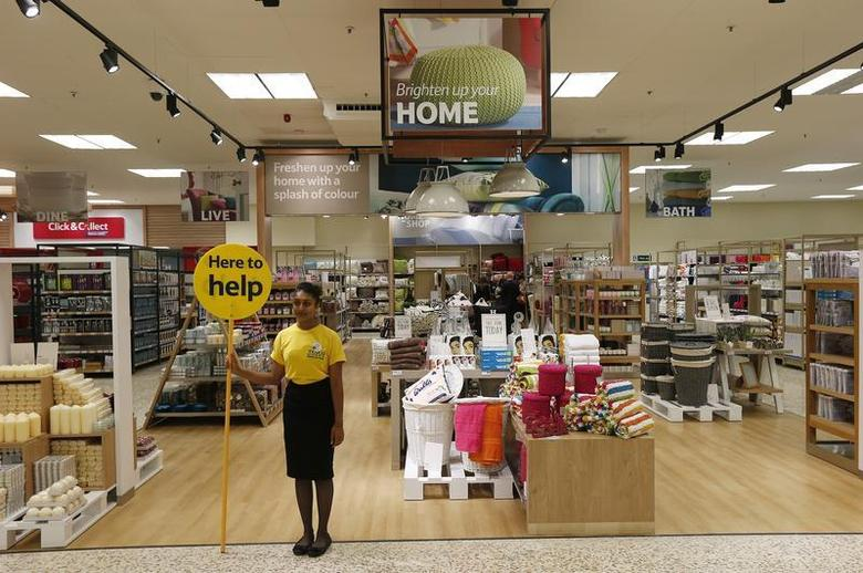 A customer service representative stands in the home ware department at a Tesco Extra supermarket in Watford, north of London August 8, 2013. REUTERS/Suzanne Plunkett/Files