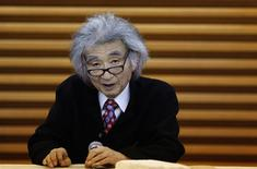 Japan's maestro Seiji Ozawa speaks during a news conference in Tokyo December 19, 2013. REUTERS/Yuya Shino