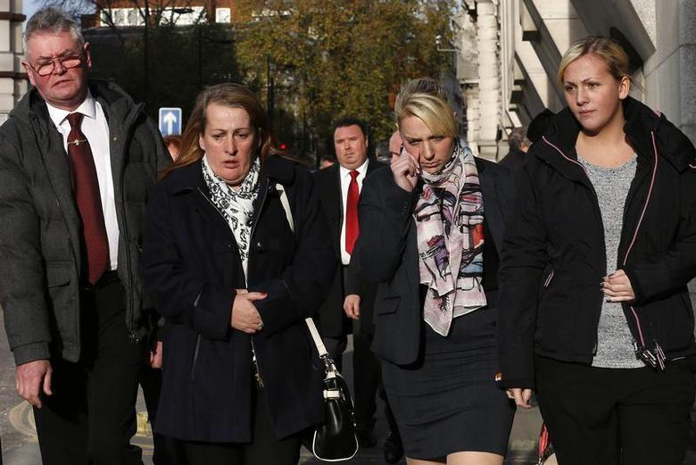 Family members of British soldier Lee Rigby leave during a lunch break in the trial of his suspected murderers at the Old Bailey in central London December 9, 2013. REUTERS/Suzanne Plunkett