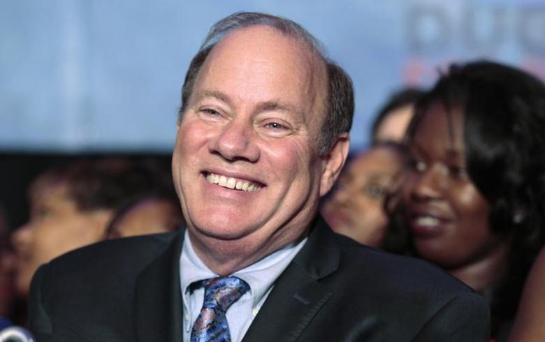 Detroit mayoral candidate Mike Duggan smiles as he addresses his supporters after being declared the projected winner on election day in Detroit, Michigan November 5, 2013. REUTERS/Rebecca Cook