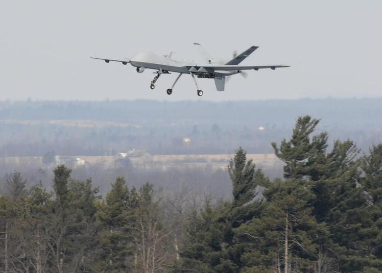 A U.S. Air Force MQ-9 Reaper unmanned aerial vehicle assigned to the 174th Fighter Wing, New York Air National Guard, takes off on a training mission at Wheeler-Sack Army Airfield, Fort Drum, N.Y. in this February 14, 2012 USAF handout photo obtained by Reuters February 6, 2013. REUTERS/U.S. Air Force/Tech. Sgt. Ricky Best/Handout