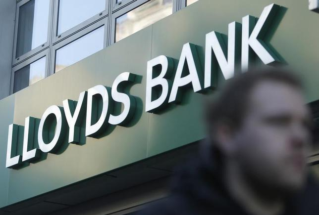 People walk past a branch of Lloyds Bank in central London December 11, 2013. REUTERS/Olivia Harris