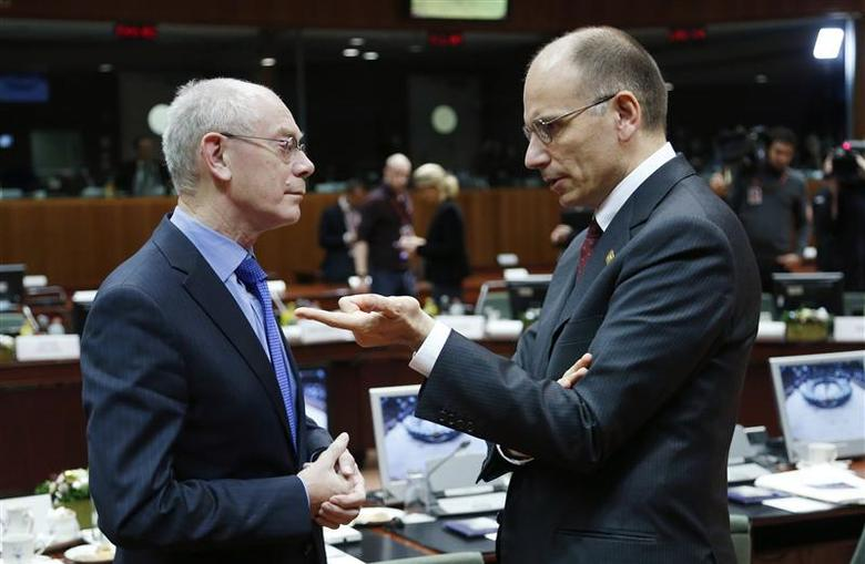 European Council President Herman Van Rompuy listens to Italy's Prime Minister Enrico Letta (R) during a European Union leaders summit in Brussels December 19, 2013. REUTERS/Francois Lenoir