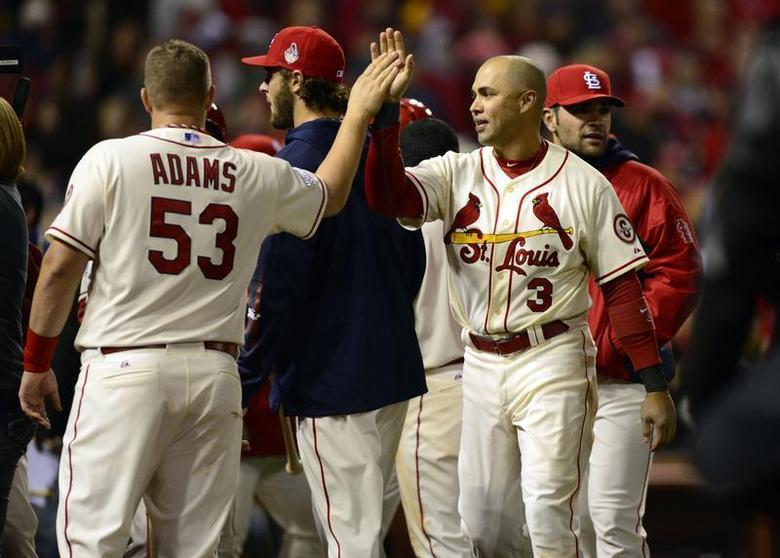 St. Louis Cardinals right fielder Carlos Beltran (3) celebrates with first baseman Matt Adams (53) after defeating the Boston Red Sox in game three of the MLB baseball World Series at Busch Stadium. Jeff Curry-USA TODAY Sports