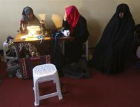 Afghan female prisoners work in a tailoring workshop at Herat prison, western Afghanistan, December 8, 2013. REUTERS/Omar Sobhani