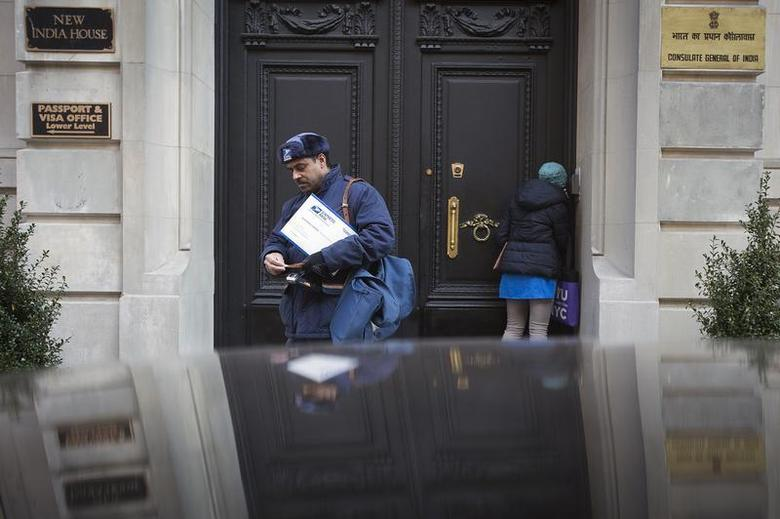 A mailman walks away from the Indian Consulate building in New York December 18, 2013. REUTERS/Carlo Allegri