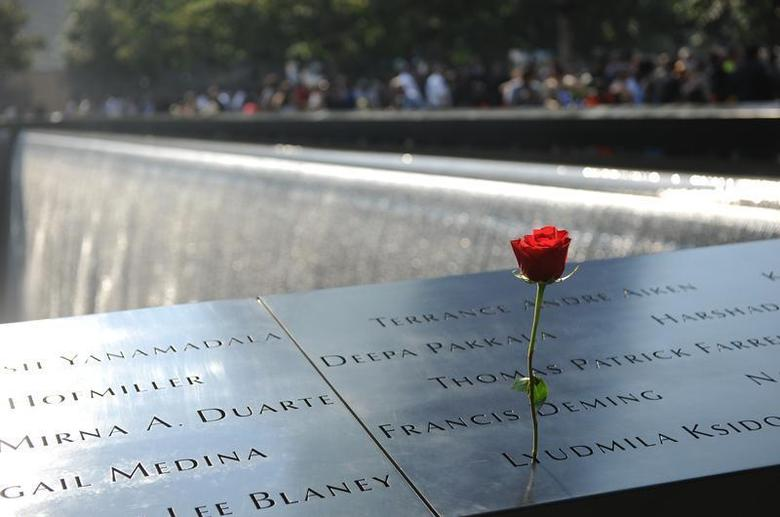 A single red rose is placed in the wall at the 9/11 Memorial during ceremony during a ceremony marking the 12th Anniversary of the attacks on the World Trade Center in New York September 11, 2013. REUTERS/ David Handschuh/Pool