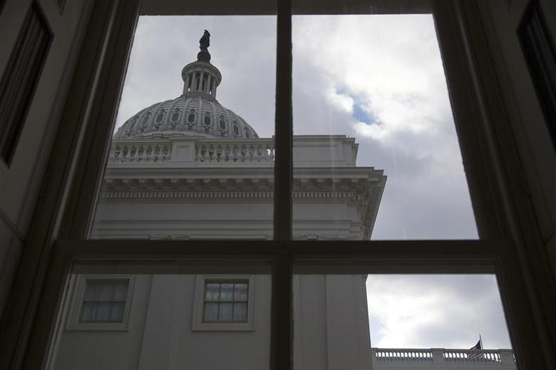 A general view of the U.S. Capitol dome as seen from a window outside the Senate chamber in Washington December 18, 2013. REUTERS/Jonathan Ernst