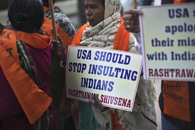 Supporters of Rashtrawadi Shiv Sena, a Hindu hardline group, carry placards during a protest near the U.S. embassy in New Delhi December 18, 2013. REUTERS/Ahmad Masood