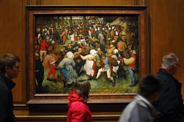 People walks past a painting titled ''The Wedding Dance'' by artist Pieter Bruegel the Elder displayed at the Detroit Institute of Arts in Detroit, Michigan December 7, 2013. REUTERS/Joshua Lott