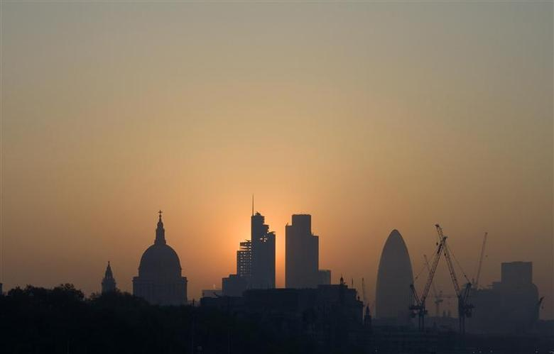 The sun rises above the financial district of the City of London in this April 23, 2011 file photo. REUTERS/Kieran Doherty/Files