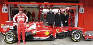 Ferrari's Formula One driver Fernando Alonso of Spain poses in front of the new Ferrari F138 racing car during a training session at Circuit de Catalunya racetrack in Montmelo, near Barcelona, February 19, 2013. REUTERS/Albert Gea