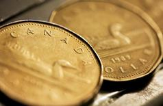 Canadian one dollar coins, also known as loonies, are displayed in Montreal, September 19, 2007. REUTERS/Christinne Muschi