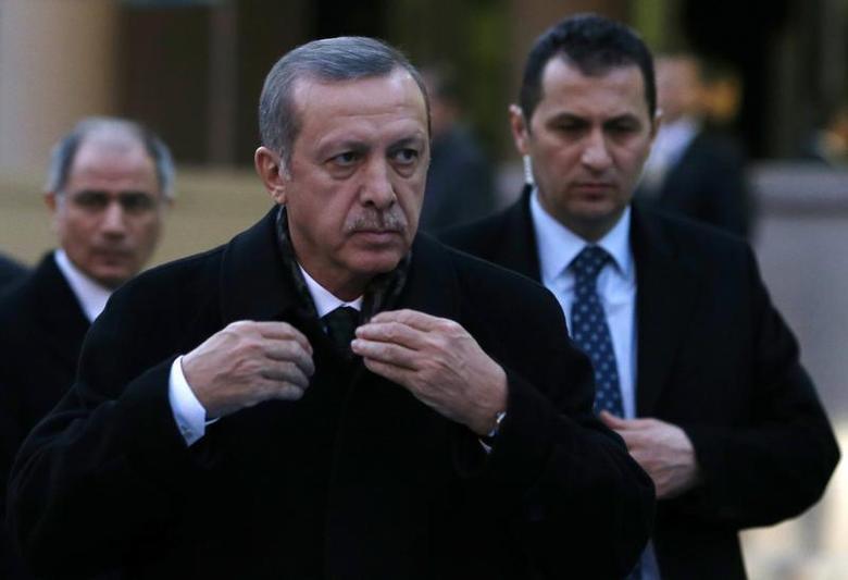 Turkey's Prime Minister Tayyip Erdogan arrives for a ceremony in Ankara December 18, 2013. REUTERS/Umit Bektas