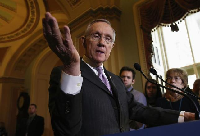 U.S. Senate Majority Leader Harry Reid (D-NV) gestures while speaking to the media following a Senate cloture vote on budget bill on Capitol Hill in Washington December 17, 2013. REUTERS/Yuri Gripas