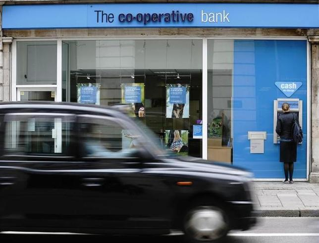 A taxi passes a branch of the Co-Operative Bank in central London June 17, 2013. REUTERS/Luke MacGregor