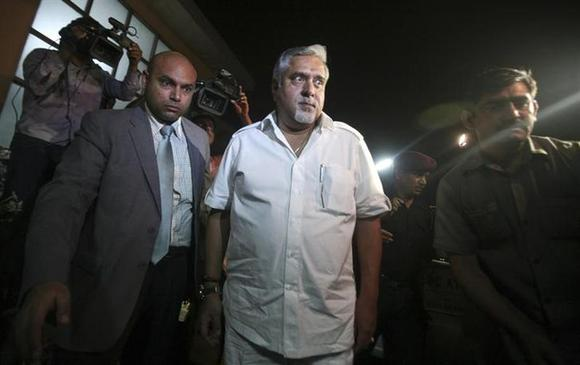 Kingfisher Airlines Chairman Vijay Mallya (C) leaves after his meeting with Director General of Civil Aviation E.K. Bharat Bhushan in New Delhi March 20, 2012. REUTERS/Parivartan Sharma/Files