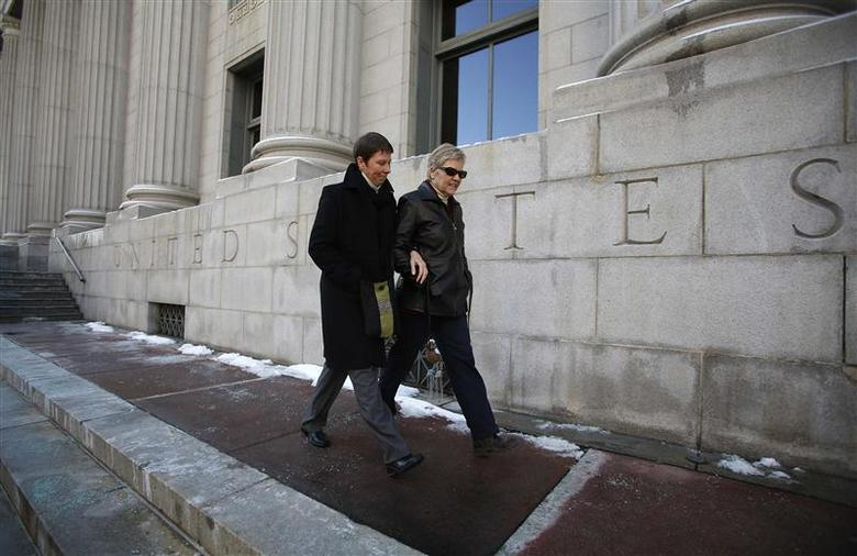 Kody Partridge (L) and her partner Laurie Wood walk from the Frank E. Moss federal courthouse in Salt Lake City, Utah in this December 4, 2013. The couple is challenging Utah's same-sex marriage ban. REUTERS/Jim Urquhart/Files