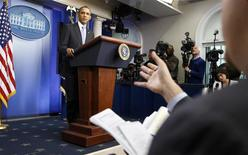 U.S. President Barack Obama holds his year-end news conference in the Brady Press Briefing Room in the White House in Washington December 20, 2013. REUTERS/Jonathan Ernst