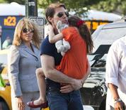 Actor Tom Cruise carries his daughter Suri into the Chelsea Piers sports facility in New York in this July 17, 2012 file photo. REUTERS/Andrew Burton