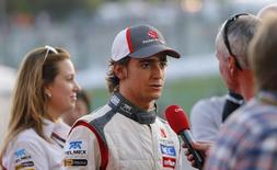 Sauber Formula One driver Esteban Gutierrez of Mexico talks to the media after the Japanese F1 Grand Prix at the Suzuka circuit October 13, 2013. REUTERS/Issei Kato