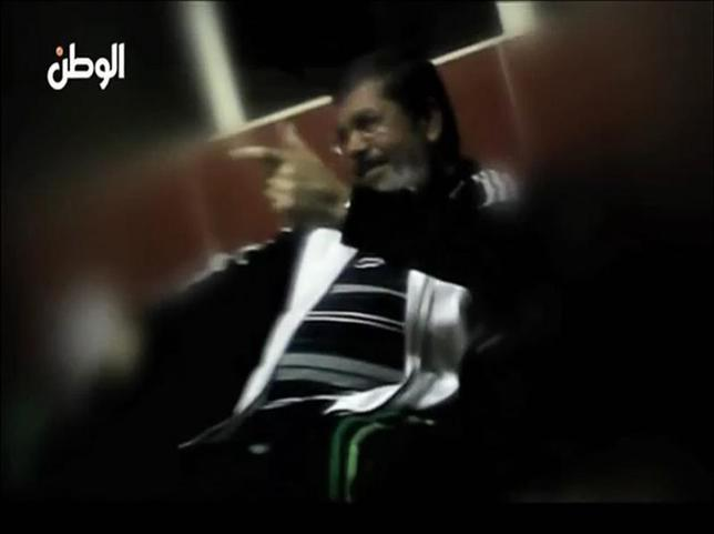 A still image taken from video released by Egypt's Al Watan newspaper shows what the newspaper says is ousted former Egyptian leader Mohamed Mursi speaking to unidentified individuals whilst in prison. REUTERS/Al Watan Newspaper via Reuters TV