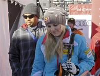 Lindsey Vonn (front R) of the U.S. and her boyfriend, golfer Tiger Woods leave after the Women's World Cup Downhill skiing race in Val d'Isere, French Alps, December 21, 2013. REUTERS/Robert Pratta