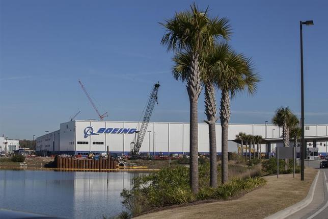 Construction cranes and palm trees line the entrance at South Carolina Boeing in North Charleston, South Carolina December 19, 2013. REUTERS/Randall Hill