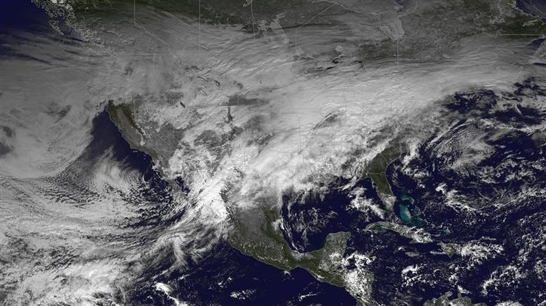 A storm system moving across the United States is pictured in this NASA handout satellite photo taken December 20, 2013. REUTERS/NASA/Handout