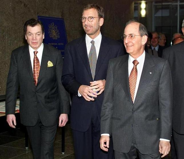Seagram Company Limited President and CEO Edgar Bronfman Jr. (C) is flanked by his father Edgar Bronfman (L) and uncle Charles Bronfmam as they arrive for the company's annual shareholders meeting in Montreal, December 5, 2000.