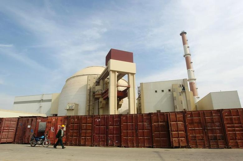 A Russian worker walks past the Bushehr nuclear power plant, 1,200 km (746 miles) south of Tehran October 26, 2010. REUTERS/Mehr News Agency/Majid Asgaripour